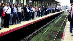 Commuters wait for trains at the Hicksville LIRR