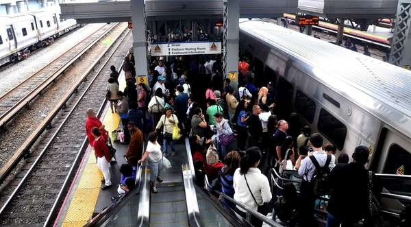 LIRR commuters crowd the platform at Jamaica Station,