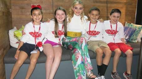 Actress Meg Donnelly with Kidsday reporters, from left,
