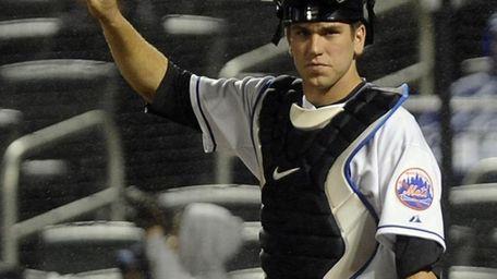 Mets catcher Josh Thole signals to his fielders