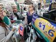 Daysi Lorenzo, center, sells lottery tickets at La