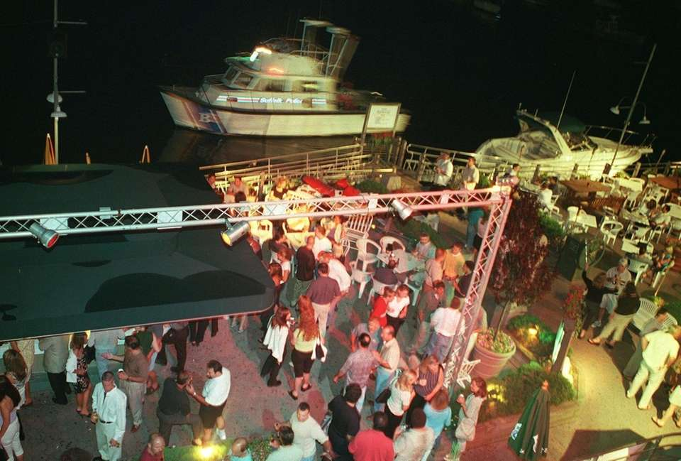 People dance, drink, and party on the deck