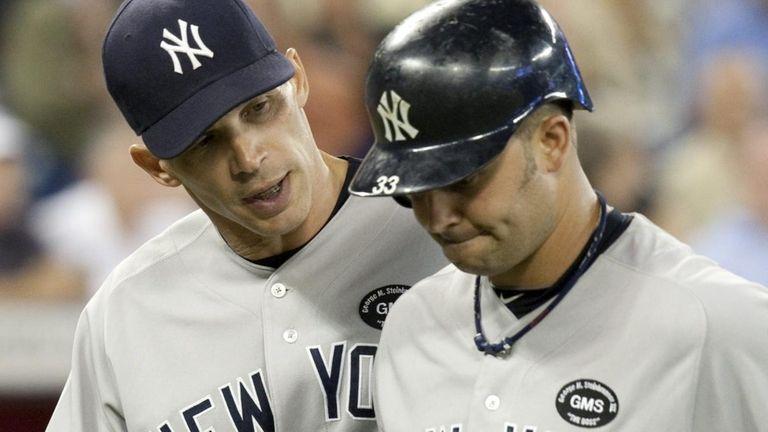 New York Yankees manager Joe Girardi, left, walks