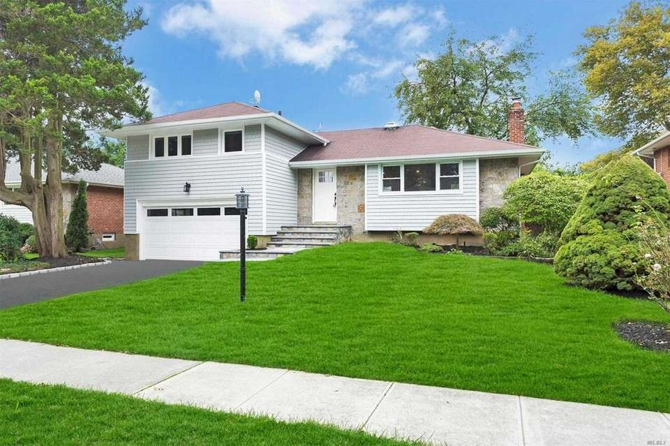This Syosset split-level includes three bedrooms and two