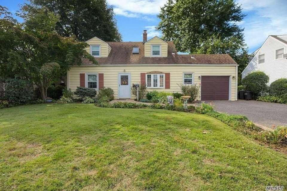 This Levittown expanded Cape includes three bedrooms and