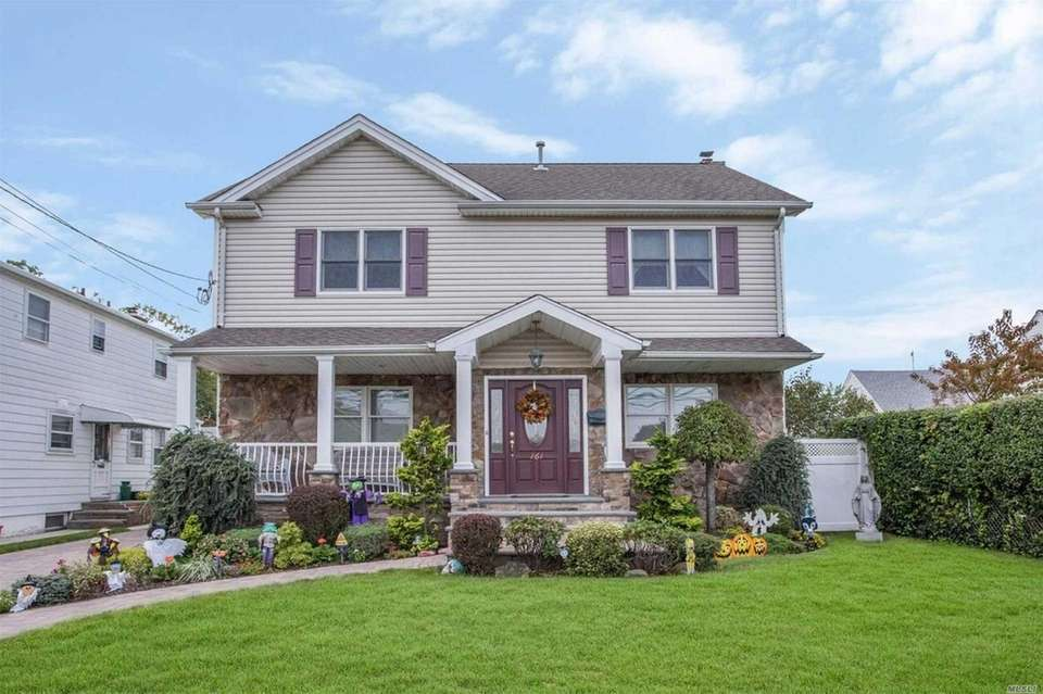 This Garden City South Colonial includes three bedrooms