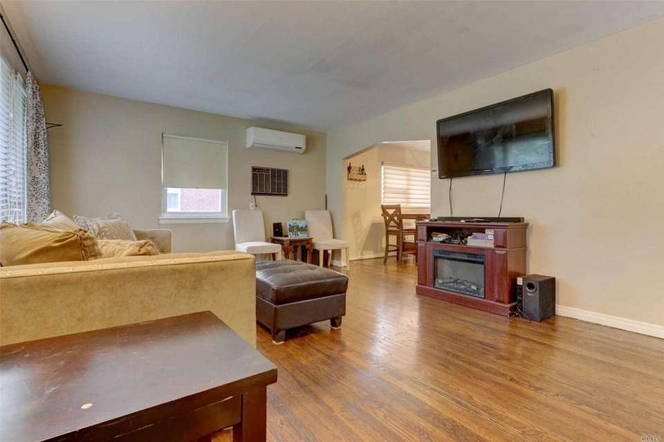 The home features hardwood floors, new central air