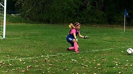 Kidsday reporter Alayna McCoy in goal for her