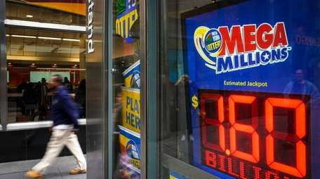 A newsstand advertises the Mega Millions lottery on