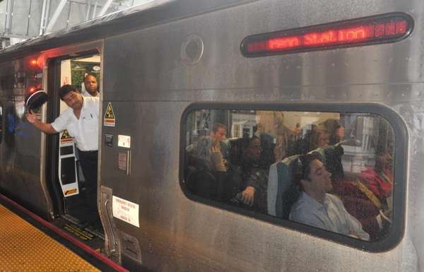 A Long Island Rail Road conductor signals