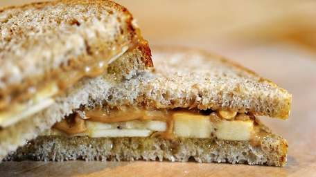 Peanut butter, honey and bananas on white whole
