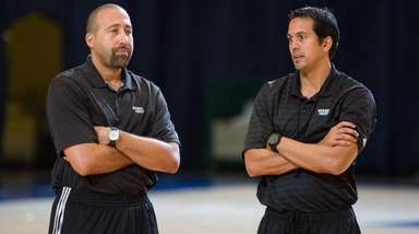 Miami Heat head coach Erik Spoelstra, right, and