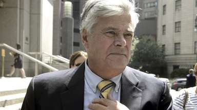 Dean Skelos exits a federal courthouse in Manhattan