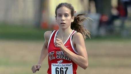 Sara Connelly wins the Suffolk girls' cross country