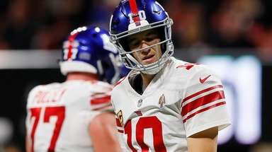 Eli Manning #10 of the Giants reacts after