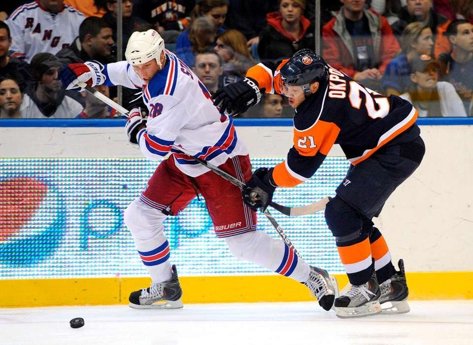 Rangers defenseman Marc Staal is chased by Kyle