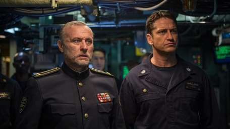 Michael Nyqvist, left, plays a Russian submarine commander