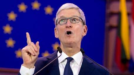Apple CEO Tim Cook speaks during a data