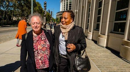 Former Assemblywoman Pamela Harris, right, leaving Brooklyn Federal