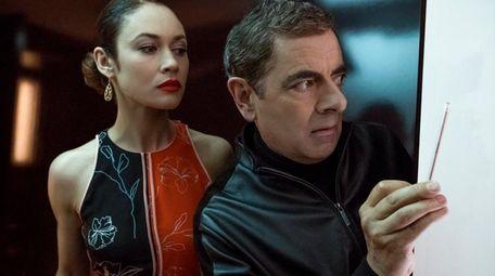 Ophelia Bulletova (Olga Kurylenko) and Johnny English (Rowan