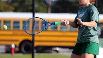 Westhampton's Juliet Tomaro returns the volley against Commack