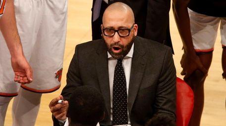 Knicks head coach David Fizdale talks to his