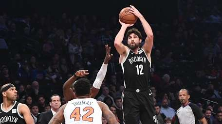 Nets forward Joe Harris sinks a three-point shot