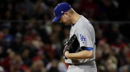 Los Angeles Dodgers pitcher Ryan Madson reacts after