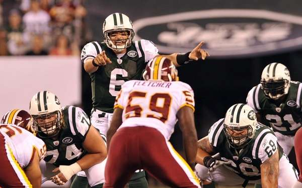 Mark Sanchez calls signals at the line of