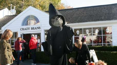 The Monster Merlin character leads the annual Halloween