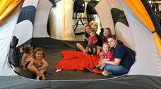 Kids and parents gather in a tent at