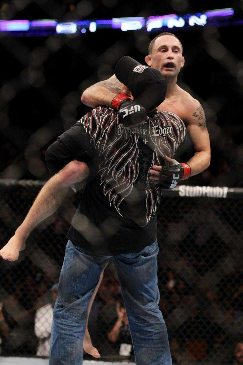 Frankie Edgar celebrates defending his lightweight title with