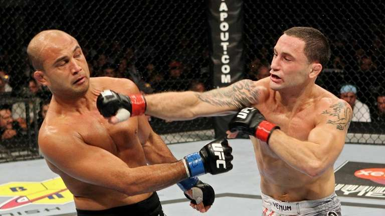 Frankie Edgar, right, and BJ Penn exchange punches