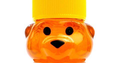 Miniature 2-ounce bottles of honey by Honey Gramz
