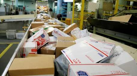 Packages travel on a conveyor belt for sorting