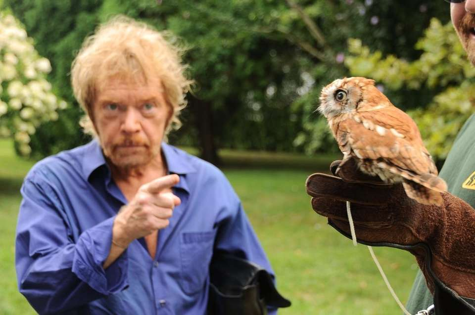Actor Kevin Conway and rescued Screech Owl