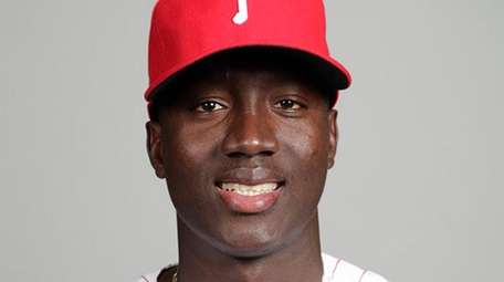 Then-Phillies pitcher Franklyn Kilomeposes for a photo during
