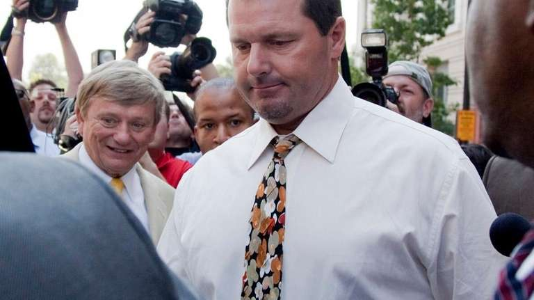 Roger Clemens leaves federal court in Washington after