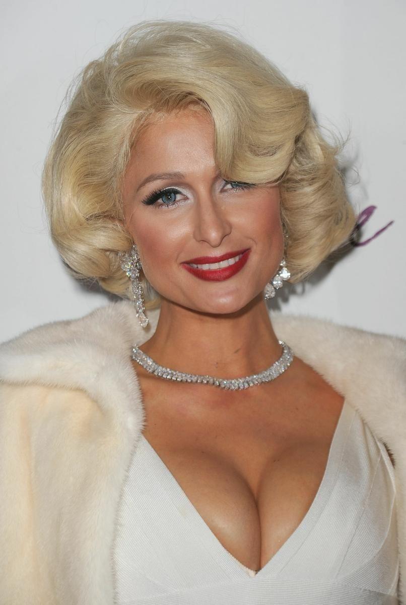 Paris Hilton arrives at the launch party for