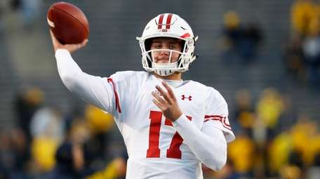 Wisconsin quarterback Jack Coan throws before a game