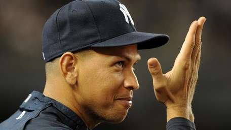 The Yankees' Alex Rodriguez signals to teammates from