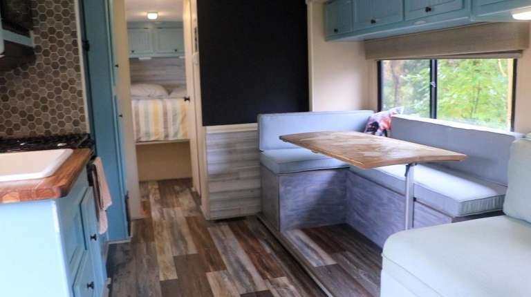 The 300-square-foot RV has a kitchen, bathroom, shower,