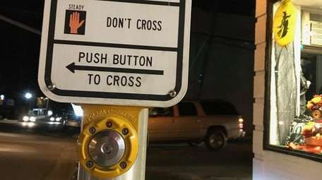 A pedestrian traffic-light button at Larkfield Road and