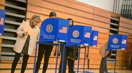Voters cast their ballots at Tthe Wheatley School