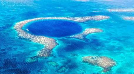 Aerial of the Blue Hole, Lighthouse Reef, Belize.