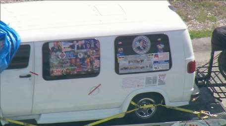 A van covered in political stickers is towed
