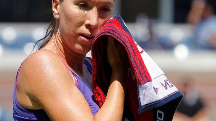 No. 4 seed Jelena Jankovic wipes her face