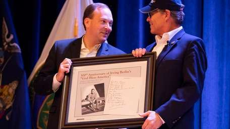 Rep. Lee Zeldin (R-Shirley) presents Perry with a
