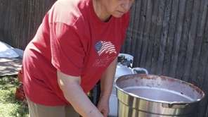 Maria Vuotto Tuosto tends tomatoes in her brother's