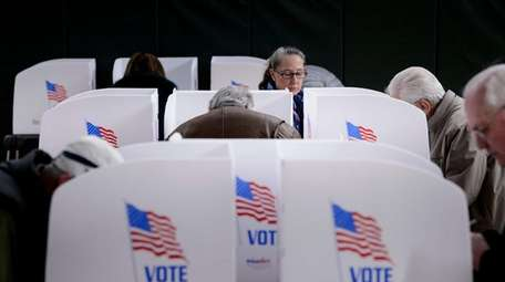 Maryland voters cast early ballots at a community